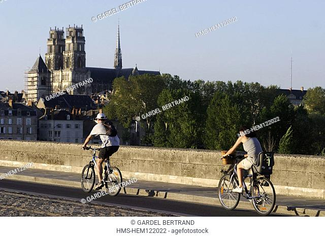 France, Loiret (45), Orléans, cyclists passing in front of Sainte-Croix cathedral