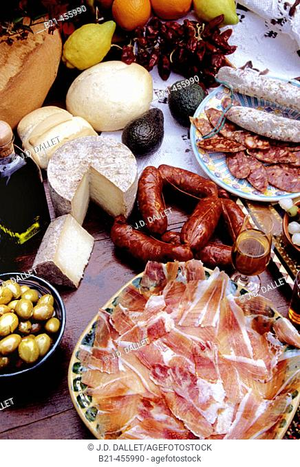 Food, goodies from Spain: 'jamon' (ham), 'chorizo' (red saussages), sherry wine, olive oil, olives, 'Manchego' cheese, oranges,..... Spain