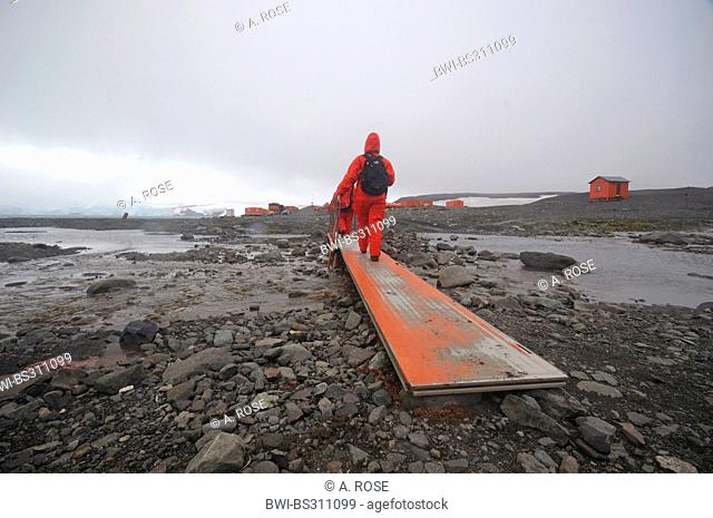 scientists of Jubany Station walking in the waste landscape of Potter Cove, Antarctica, King George Island