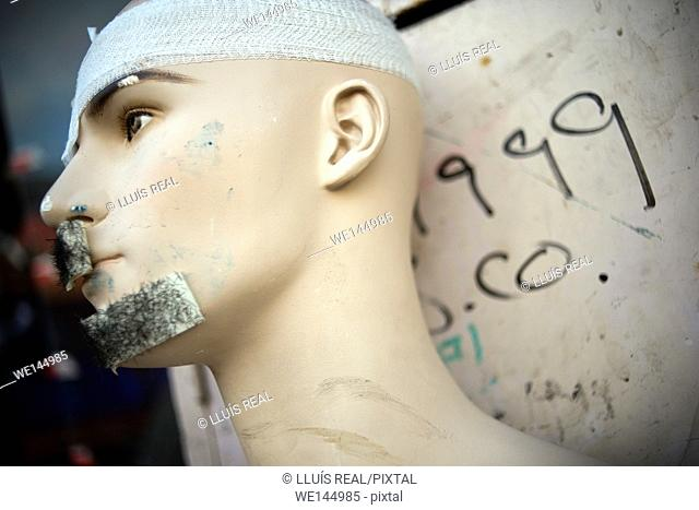 Close-up of a head of a porcelain mannequin intriguing aspect