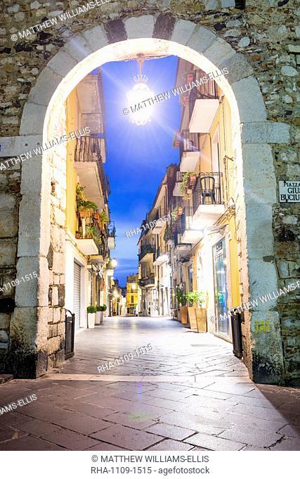 Porta Catania, one of the entrances to Corso Umberto, the main street in Taormina at night, Sicily, Italy, Europe