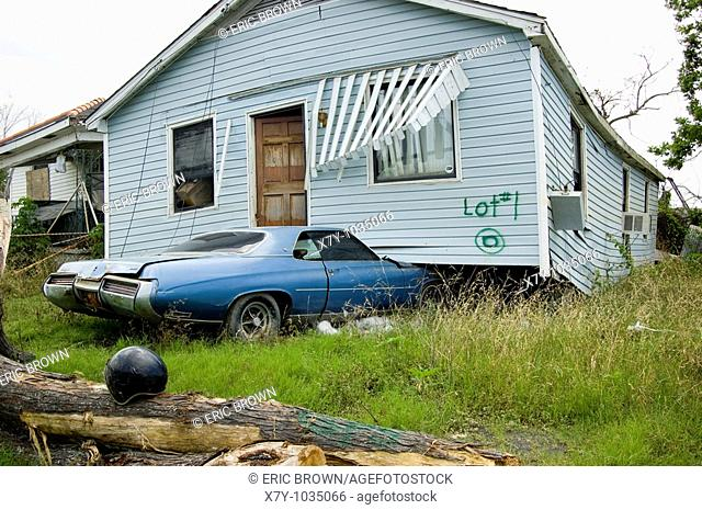 A home sits atop a car in the Lower Ninth Ward, New Orleans