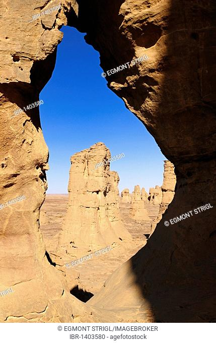 Hole in the rock of El Ghessour, Tassili du Hoggar, Wilaya Tamanrasset, Algeria, Sahara, North Africa