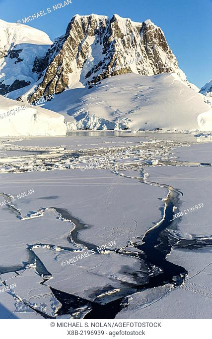 Transiting the Lemaire Channel in heavy first year sea ice, Antarctica