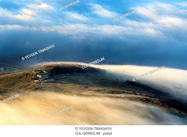 View of dispersing mountain mist from Luchistoye Village, South Demergi mountain, Crimea, Ukraine