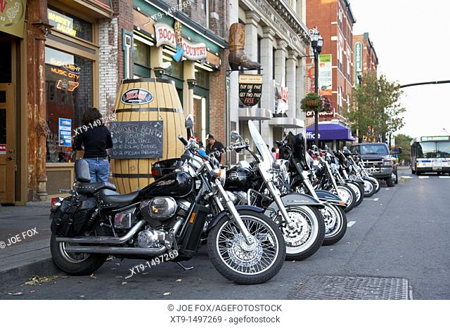 row of motorcycles including harley davidson on broadway downtown Nashville Tennessee USA
