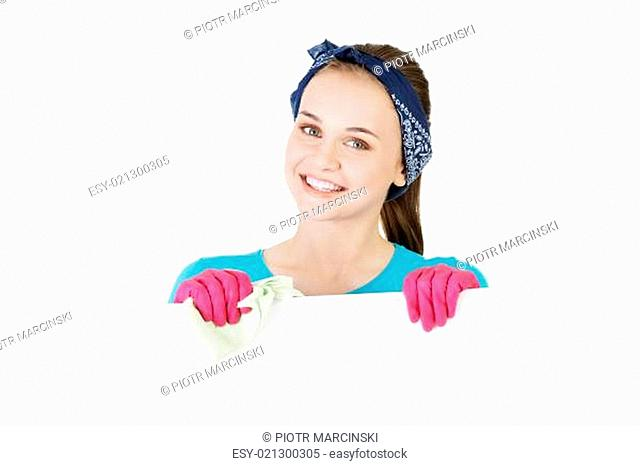 Happy cleaning woman showing blank sign board