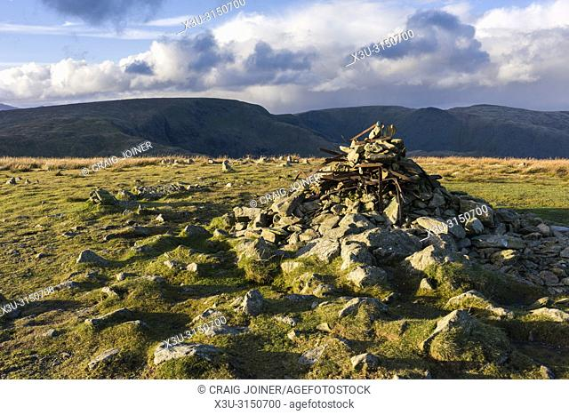 Cairn on the summit of Harter Fell with High Street beyond in the Lake District National Park, Cumbria, England