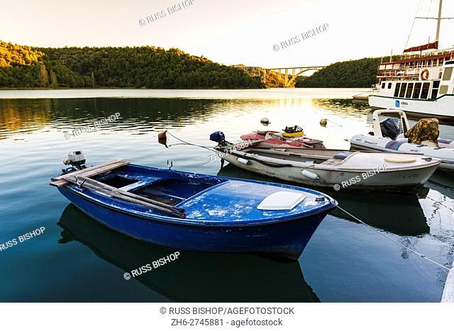 Boats docked on the Kirka River at sunset, Skradin, Dalmatia, Croatia