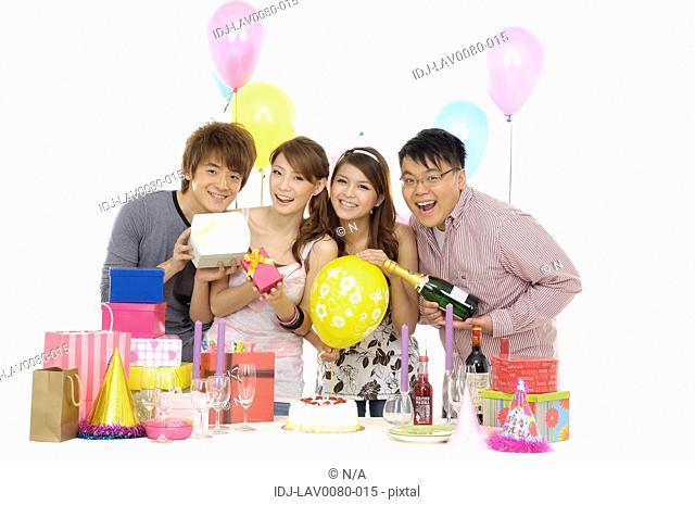Friends celebrating a birthday party