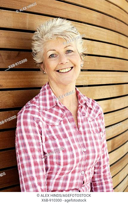 Attractive happy and healthy senior woman with a youthful style
