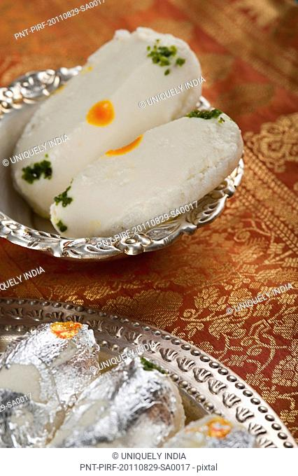 Close-up of cham cham a traditional Indian sweet made from chhena (cottage cheese) and khoya (solid milk)