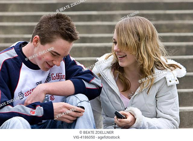 Teenage boy with mobile phone - , Schleswig-Holstein, Germany, 05/04/2007