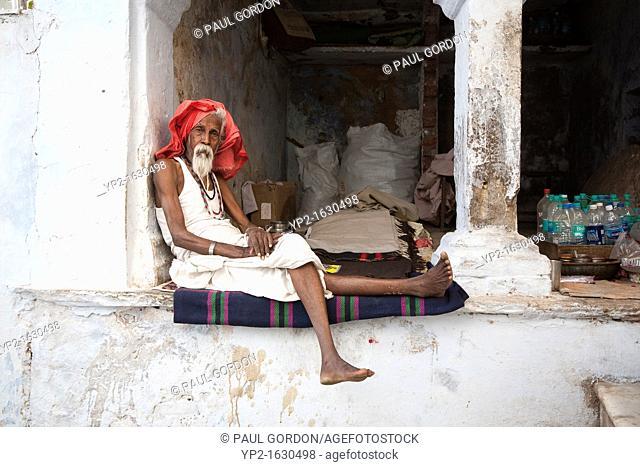Sadhu resting in an archway, Pushkar - Rajasthan, India