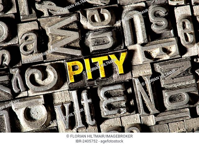 Old lead letters forming the word PITY