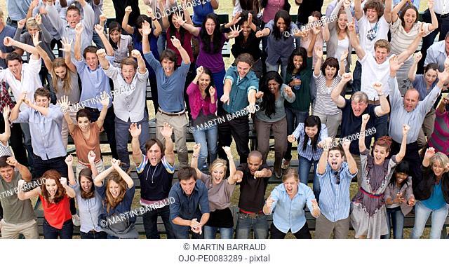 Cheering crowd in bleachers