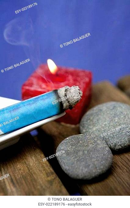 Natural theraphy, stones, and candles over wood