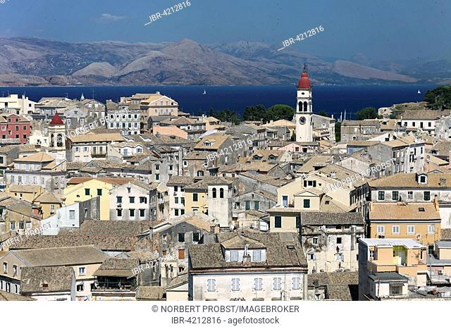 Seaside housing with St. Spiridon Church and the Albanian coast, historic centre, Corfu, Kerkyra, Unesco World Heritage Site, the island of Corfu