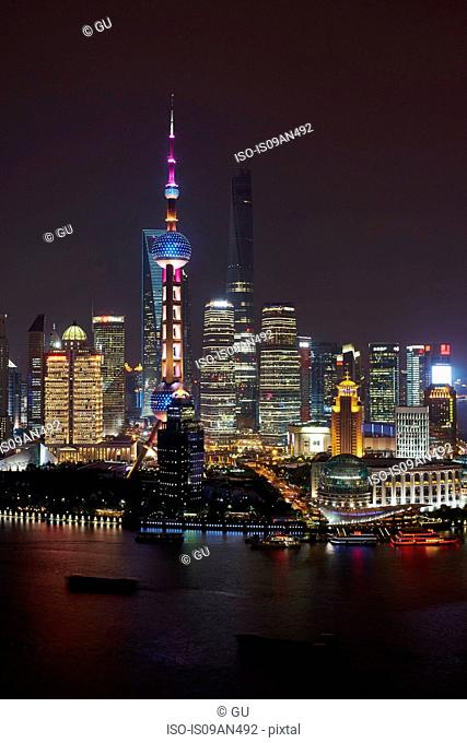 Oriental Pearl Tower at night, Shanghai Tower (under construction) and Shanghai World Financial Centre in Pudong, Shanghai, China