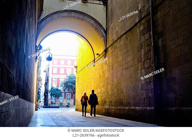 Couple walking along a street. Carrer de la Mercè, Barcelona, Catalonia, Spain