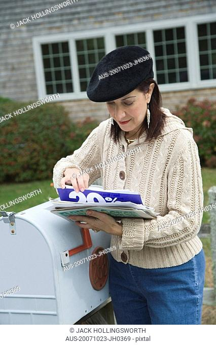 Mature woman checking mails