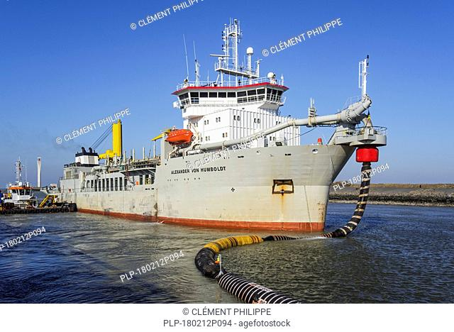 Dredger working in port Stock Photos and Images | age fotostock