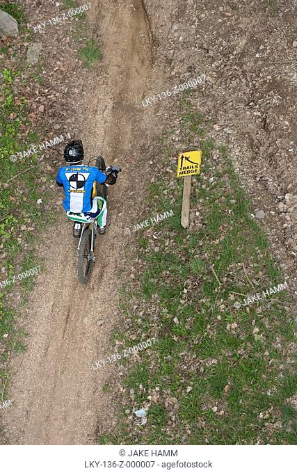 Looking down on man riding dirt bike