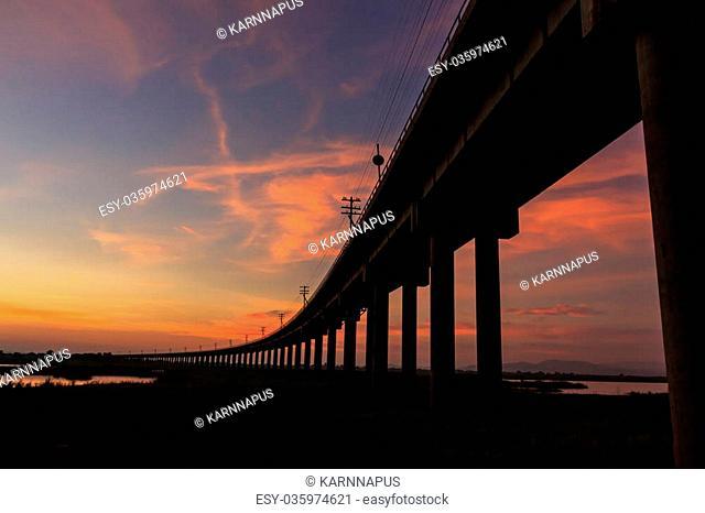 A train bridge at Pa Sak Jolasid Dam, Thailand in sunset time