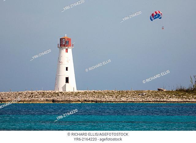 A parasail passes Paradise Island Lighthouse, Nassau, Bahamas, Caribbean