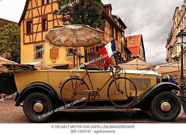 Old Citroen with original bicycle of the Tour de France, 1932 in the city center, Colmar, Elass, France, Europe