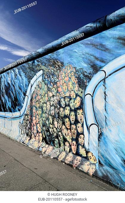 The East Side Gallery a 1.3 km long section of the Berlin Wall Mural known as It happened in November by Kani Alavi
