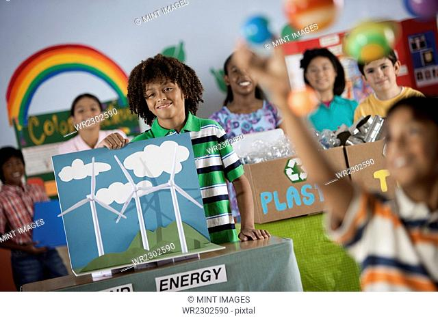 A class of children at a Green Science Fair event, with presentations on solar power and recycling