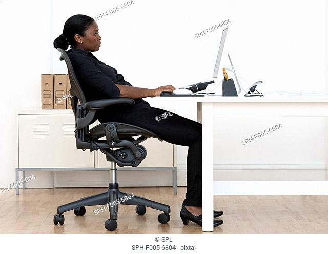 MODEL RELEASED. Incorrect seated posture