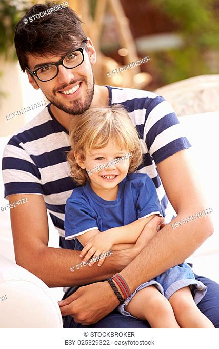Portrait Of Father And Son Playing Outside Together