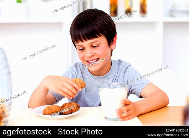 Portrait of a cute boy eating biscuits