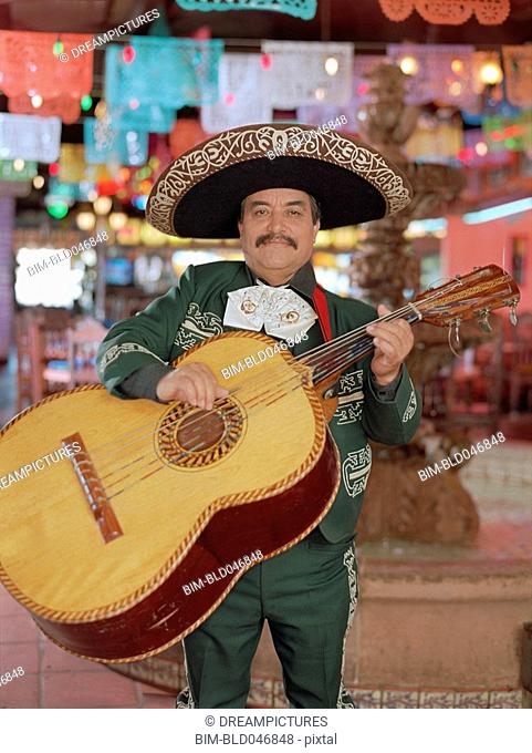 Hispanic mariachi musician playing guitar