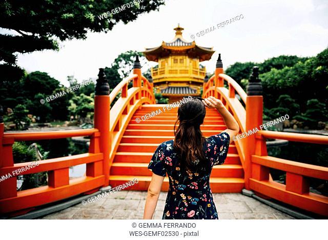 China, Hong Kong, Diamond Hill, Nan Lian Garden, Female tourist lookint at Golden Pavilion of Absolute Perfection