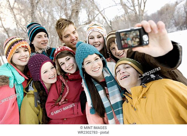 A group of friends posing for a selfy in the snow