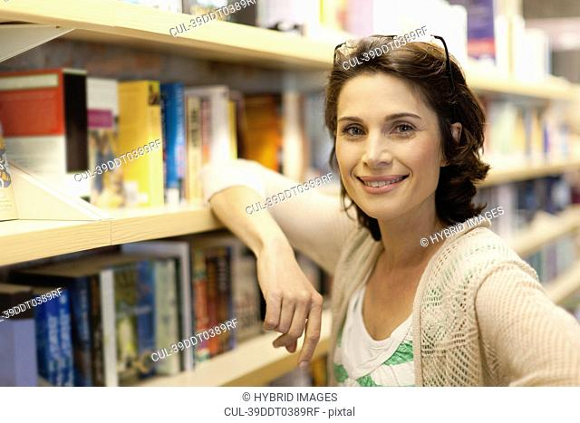 Woman smiling in library