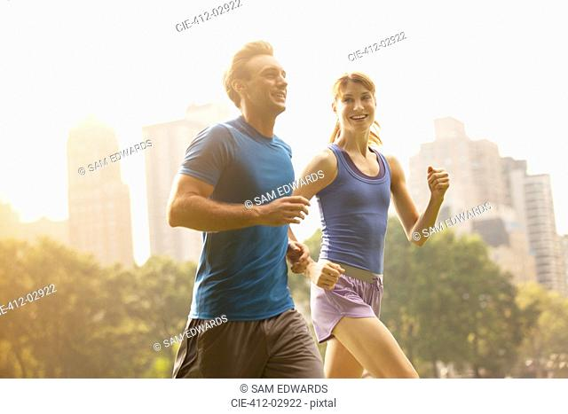 Couple running in urban park
