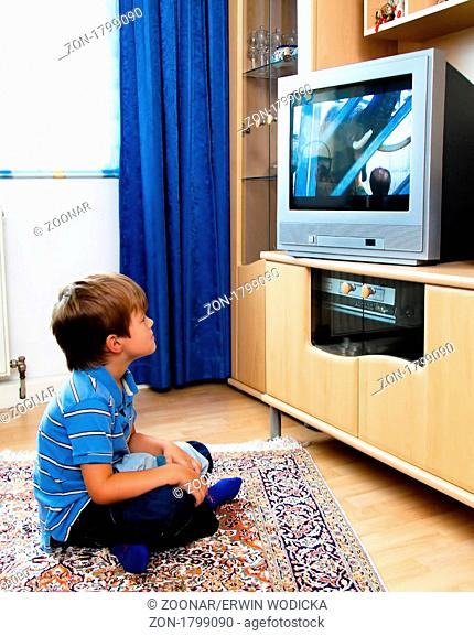Little kid watching TV with TV