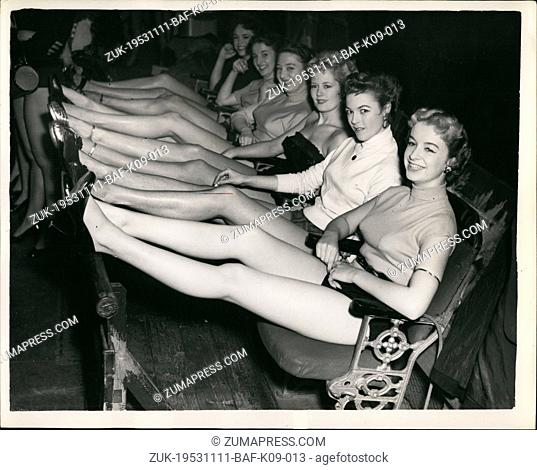 Nov. 11, 1953 - Search Continues for the 'Perfect legs'.: Photograph Peter Peck was to be seen at the Adelphi Theatre, London
