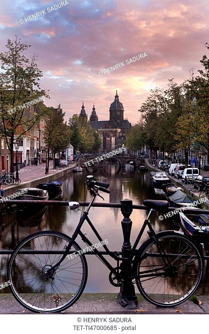 Basilica of st nicholas and bicycle by canal in city