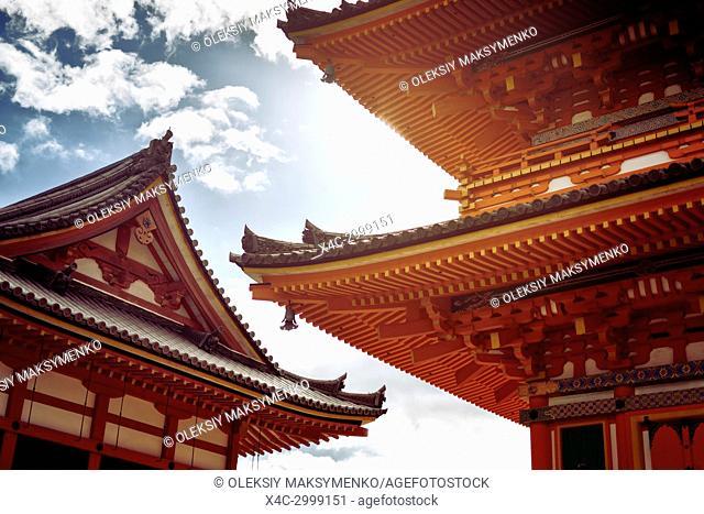 Architectural detail of Sanjunoto bright orange pagoda building at Kiyomizu-dera Buddhist temple in Kyoto, Japan
