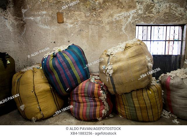 Ecuador, Salinas, sacks of wool