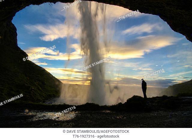 Beautiful Seljalandfoss waterfall lit up at sunset, southern Iceland