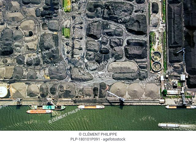Aerial view over bulk carriers loading coal at SEA-invest / Ghent Coal Terminal at the port of Ghent, East Flanders, Belgium
