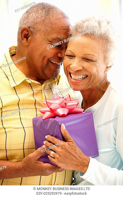 Senior man giving gift to wife