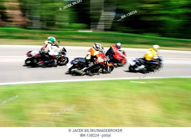 Motorcycles driving fast