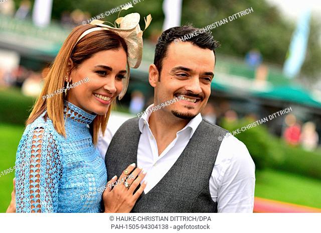 Moderator Jana Ina Zarrella and her husband, musician Giovanni Zarrella at the Ascot horse race day in Hanover (Germany), 20 August 2017